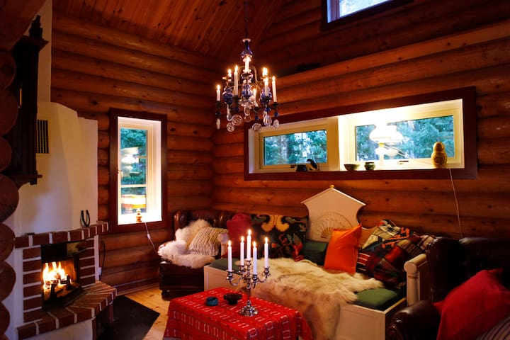 Autumn weekend in quiet log house in the forest