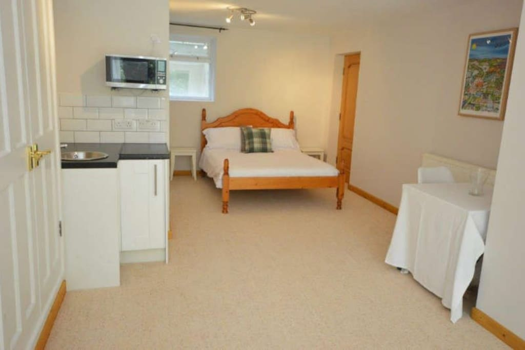 Double bed with kitchenette and dining