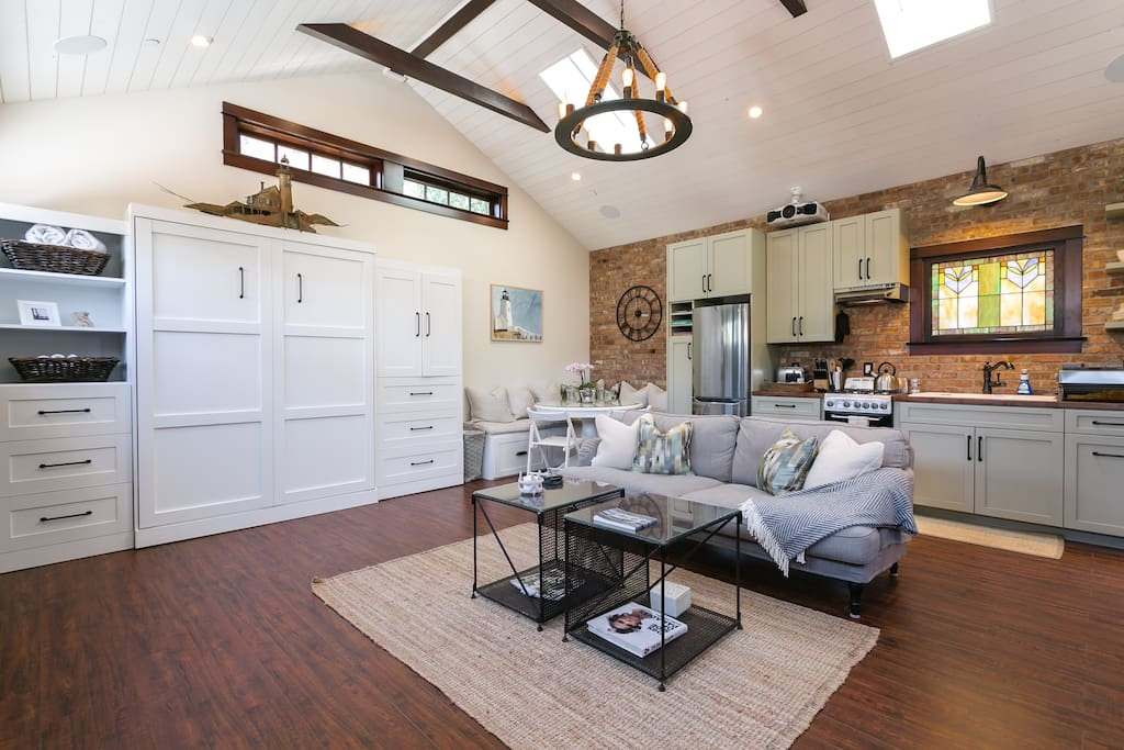 Cathedral ceilings, skylights, modern light fixtures--plenty of beautiful light (and shades when you want to block it out)...