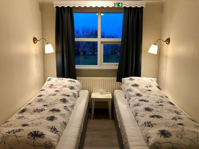 The twin room with two single beds and a closet.