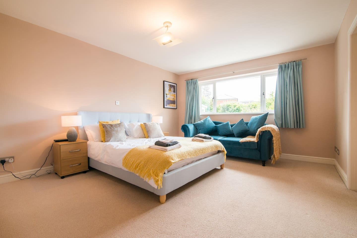First floor bedroom One with king size bed and full ensuite with bath