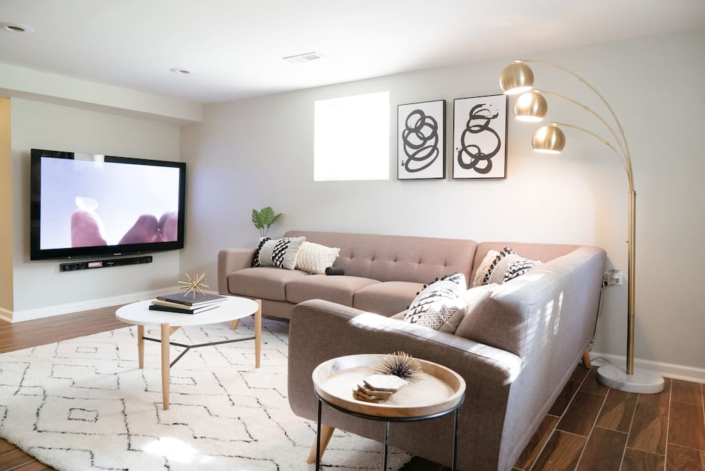 """Living room with 65"""" TV with Xfinity Cable and Netflix"""