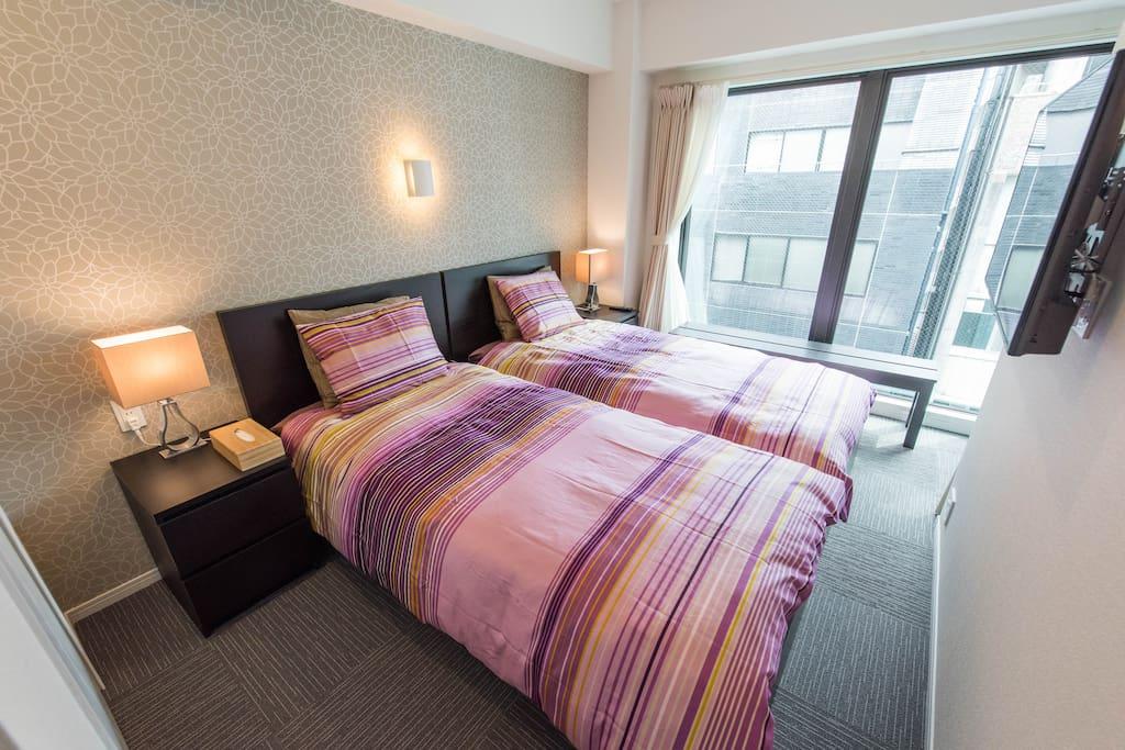 bedroom 1 w/ TV