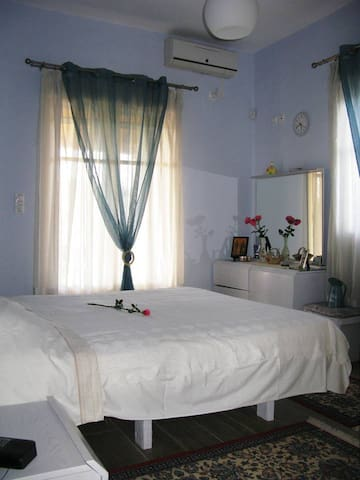 House 2, Bedroom 1: Comfortable and welcoming with a double bed and the colours of sky and sea