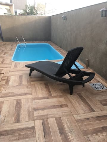 Casa aconchegante e segura com piscina e churrasq