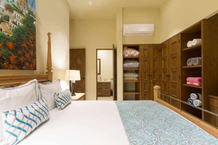 Comfortable second bedroom with TV desk and direct access to second bathroom