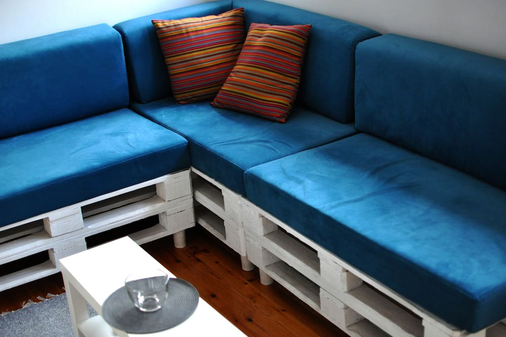 Private living room with funky sofa made of white pallets