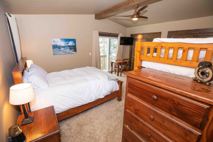 Upstairs Master Suite Queen Bed Twin Bunk Beds Walk in Closet Private Balcony, Workspace & Full Master Bathroom.