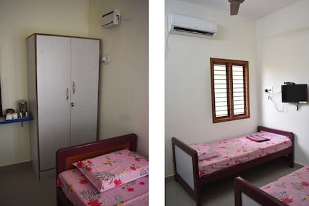 Vairam's (2 rooms + Cozy Living Room)
