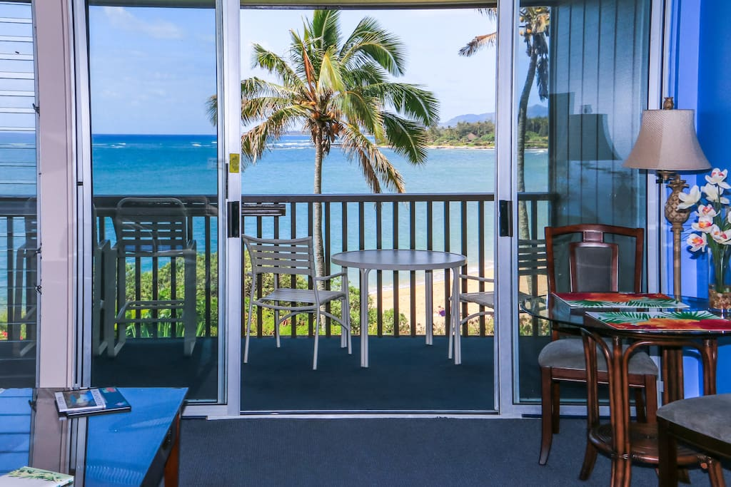 Enjoy a glass of wine inside or outside with the oceanfront view from this affordable east shore condo