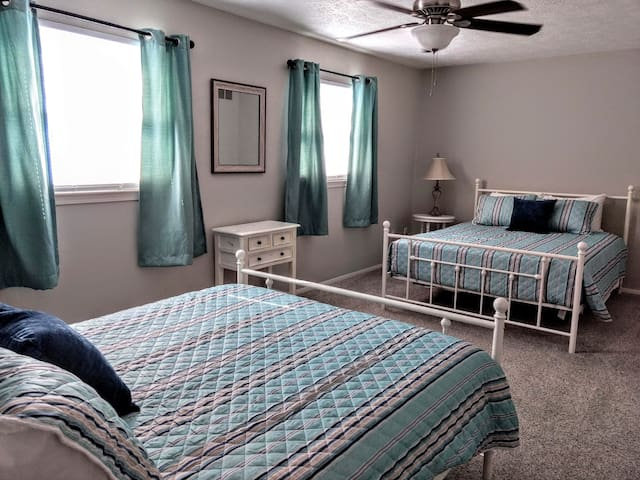 Second bedroom has two queen beds with brand new mattresses and bedding