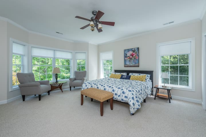 """Huge Master Bedroom with Bay Window View of the Mountains Through 64"""" Tall Windows!  King Bed, Duvet, Extra Pillows, and More!  Baby PlayPen, Ironing Board/Iron in Closet.  43"""" Roku TV on Antique Dresser!"""