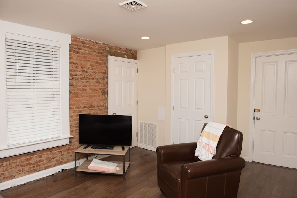 Exposed brick and wood floors add to the charm of this unit.