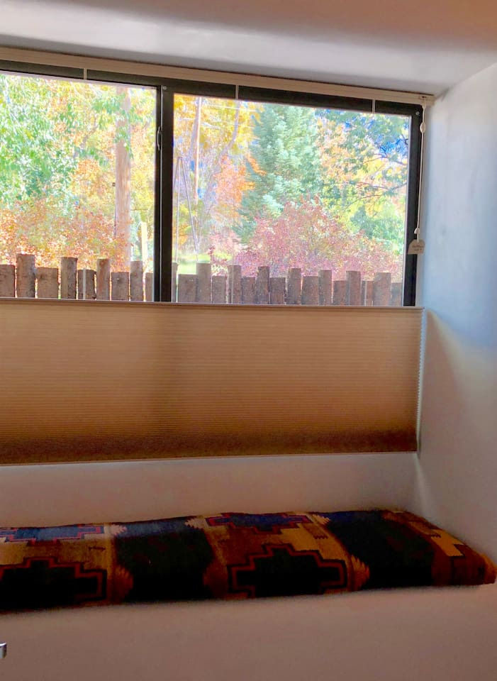 Window seat with Fall colors on display