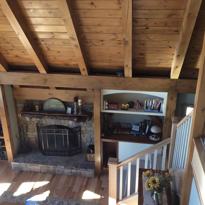 Looking down on Living room from upstairs guestroom