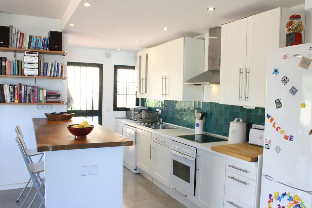 Kitchen with dish washer, oven, toaster etc