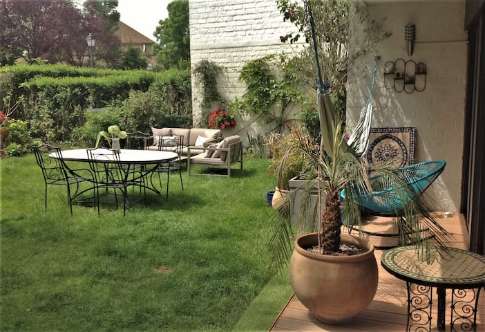 Apartment 100m² with large garden 30 'from Paris