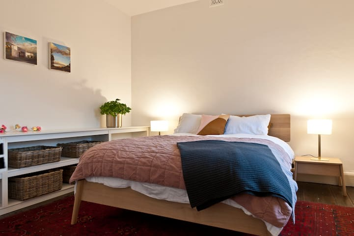 Queen bed with luxurious linen