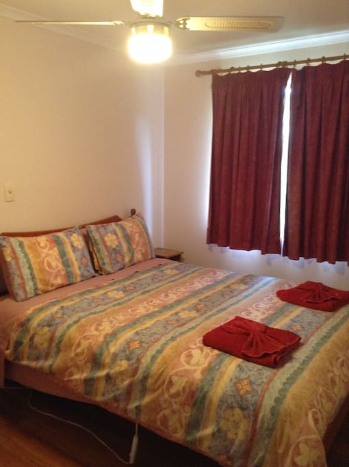 Comfortable queen bedroom with built in robes and country views