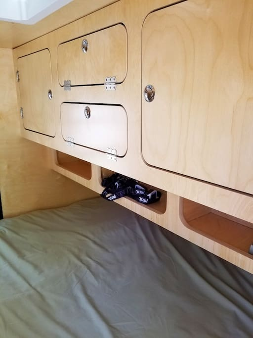 Custom wood cabinetry to stow your gear.