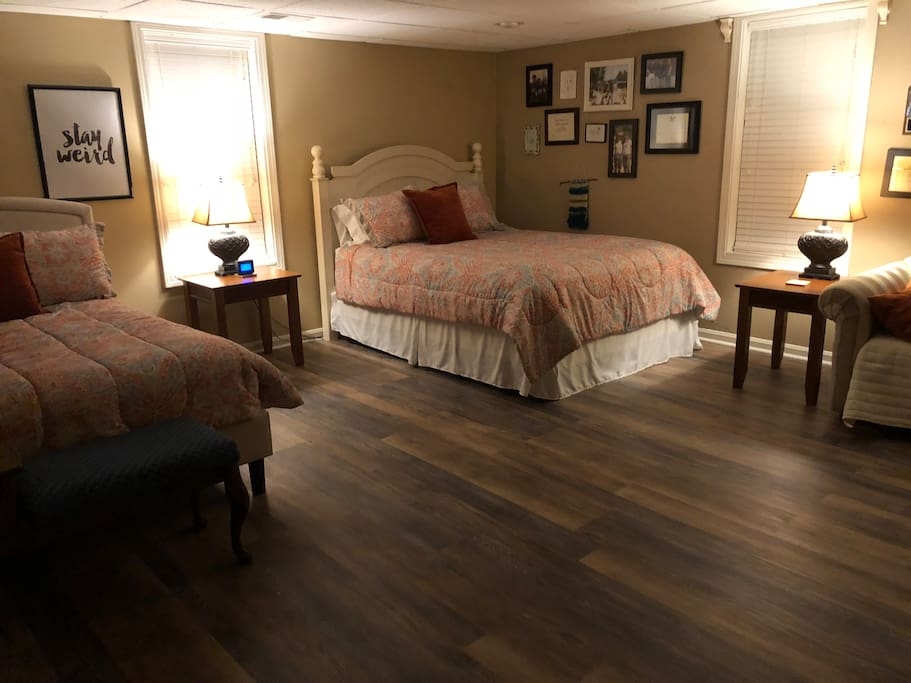 Private basement room with 1 queen bed, 1 full size bed, and single hide-a-bed sleeps 5.