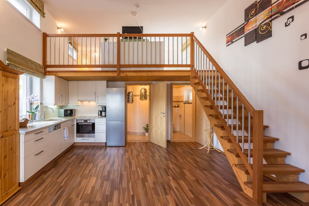 kitchen with stairway to open bedroom