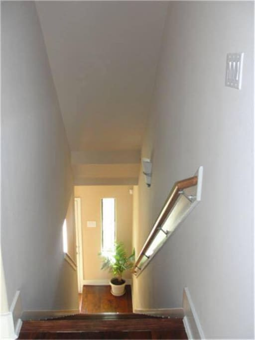 Stairs leading from the front door up to the second story.