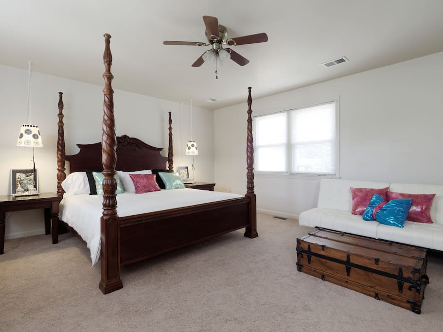 The master bedroom has a king size bed, tv with Roku and remote controls for both, an additional full size futon sleeper and a private bathroom.