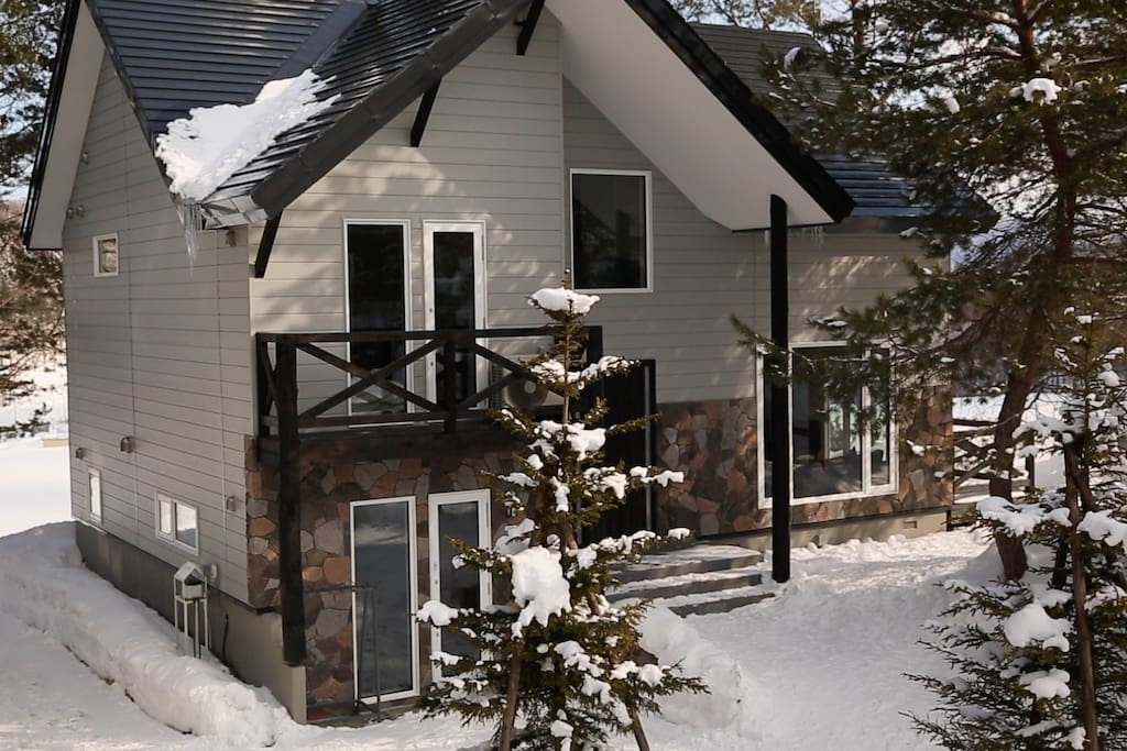 A winter view of the property.  Note: the sub-level of the property below the front steps is a separately zoned studio apartment that the Host currently uses as an on-site Guest Services Office. This studio space is separately keyed from the main Chalet and advanced sound proofing minimises sound transference.