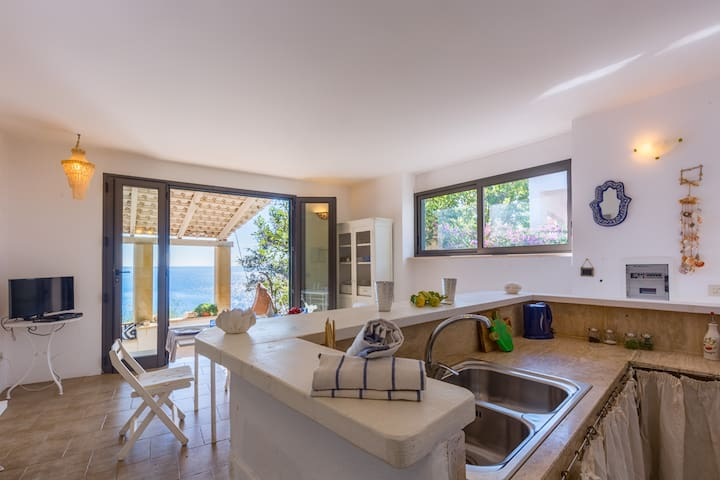 kitchen and living room overlooking the sea