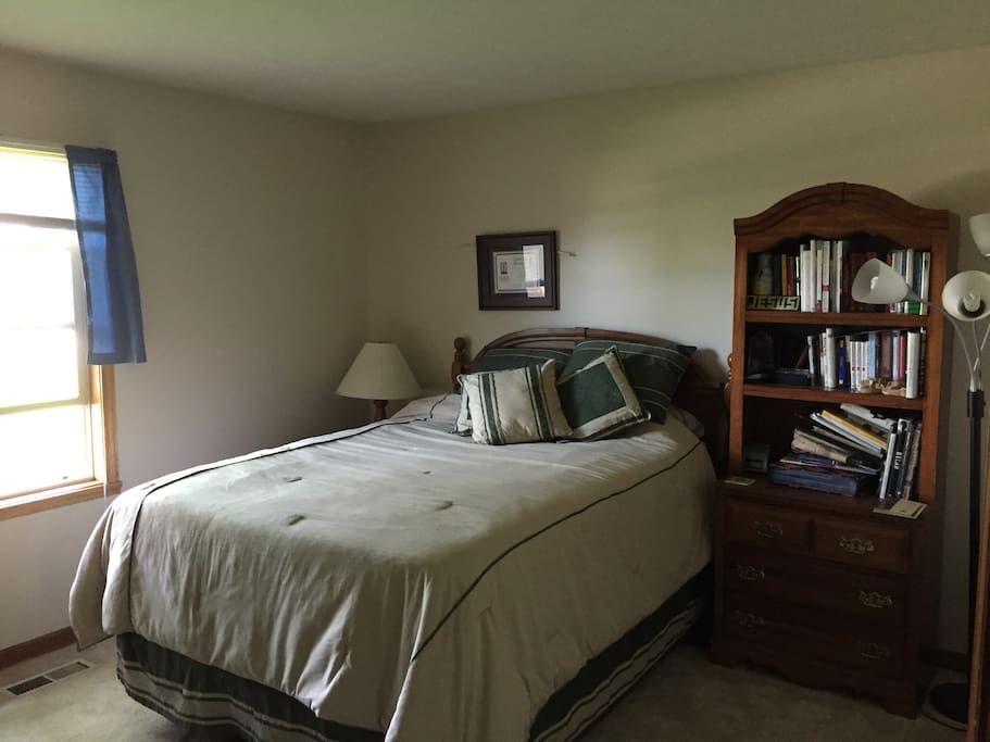 Queen bed - natural light pours in from window