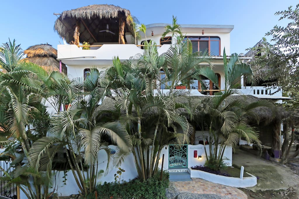 Casa Suenos del Mar front view with Penthouse palapa terrace prominent