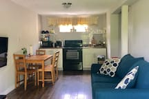 Front door opens up into a living room with cable TV, 4 person kitchen table, full kitchen.. full stove and fridge included and a sleeper sofa that can serve as a couch or open into a full bed that sleeps 2 people. Clean linens and pillows provided.