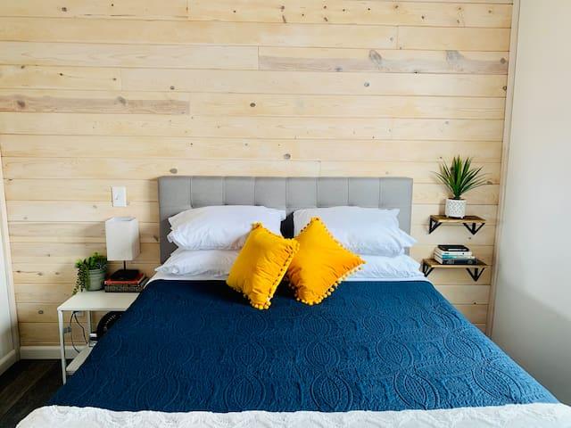 Bedroom with queen sized memory foam mattress.