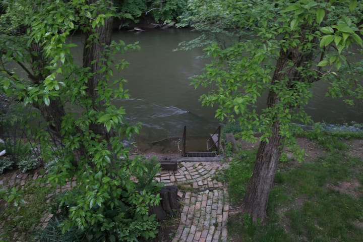 View of stairs and creek from porch