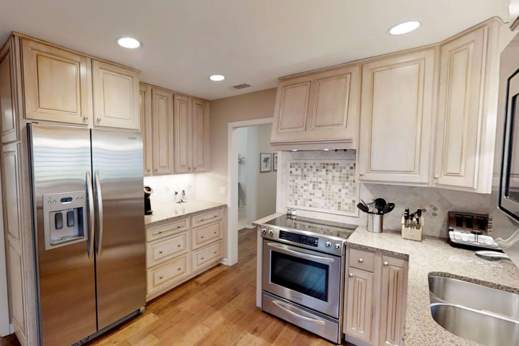 Completely updated kitchen with granite counter tops, high end cabinetry, stainless appliances and everything you need to prepare gourmet meals.