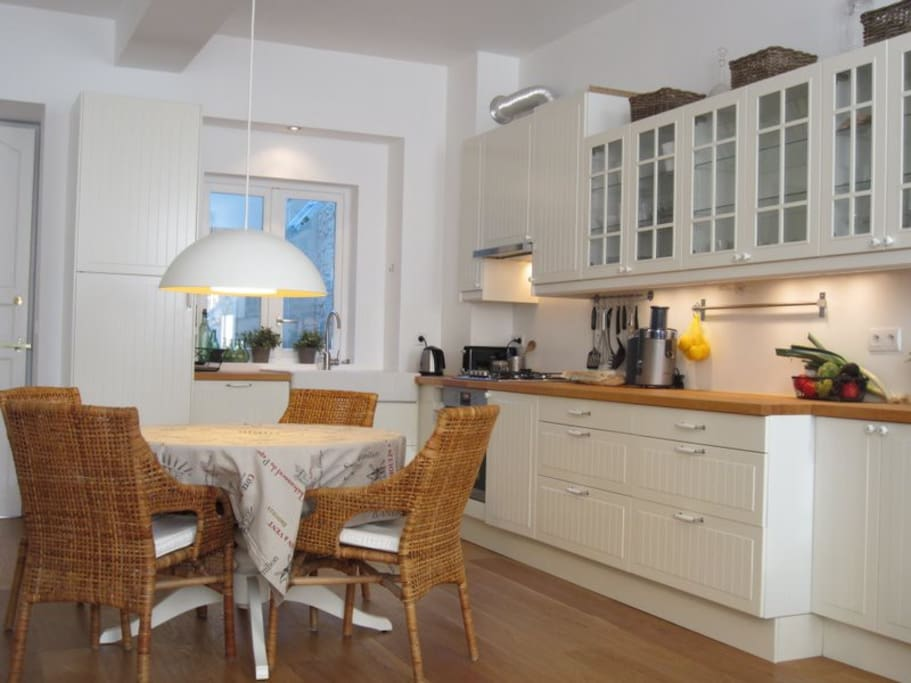 Dining room table with full kitchen.