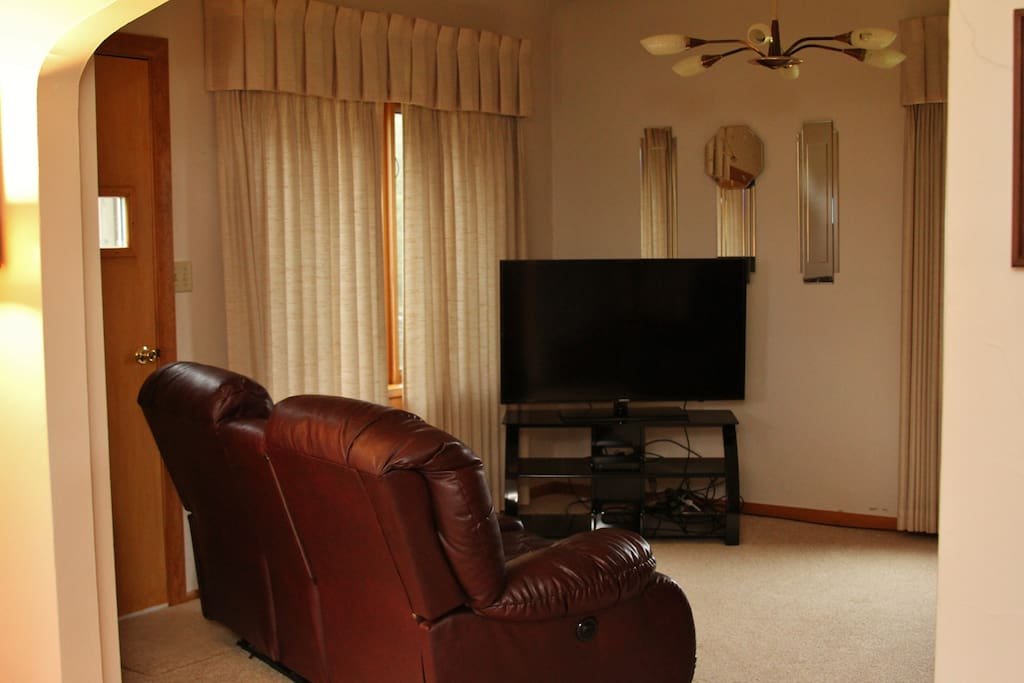 Living room with comfy loveseats and satellite TV.