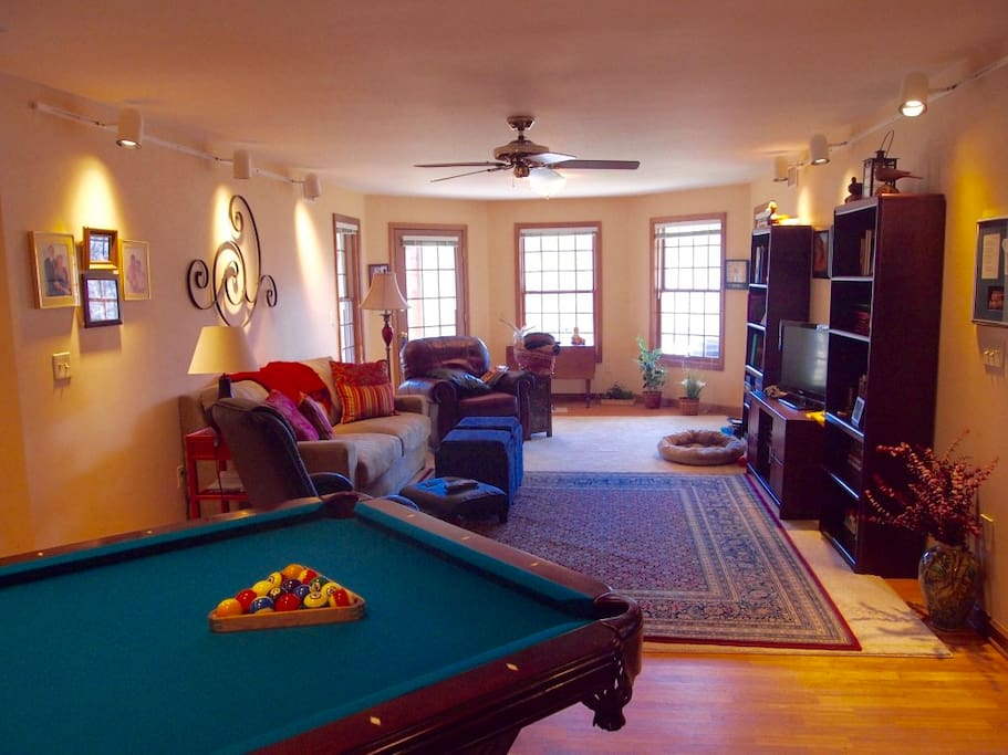 View of main living area with views of lake and pool table