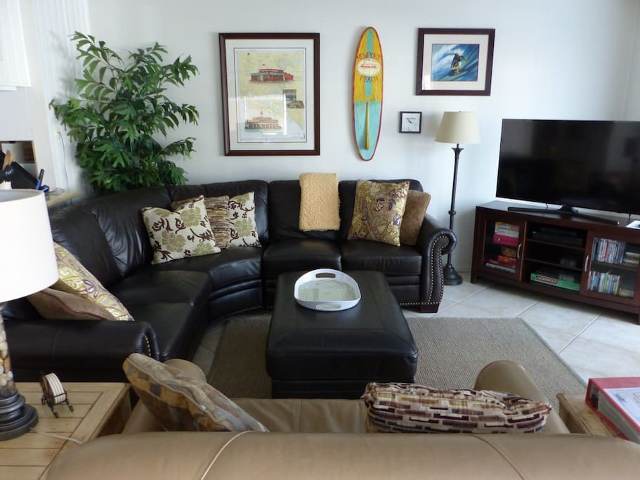 Living Room, so comfortable w/2 leather couches and a new flat screen and furniture console