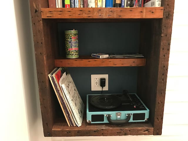 Old style turntable and a growing collection of records - just for fun!  You can also connect your own digital music to the bluetooth speakers