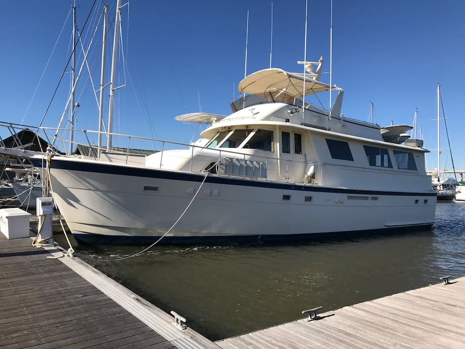 Southern Comfort dockside. 61 foot Hatteras Motor sleeps 8 in 4 staterooms