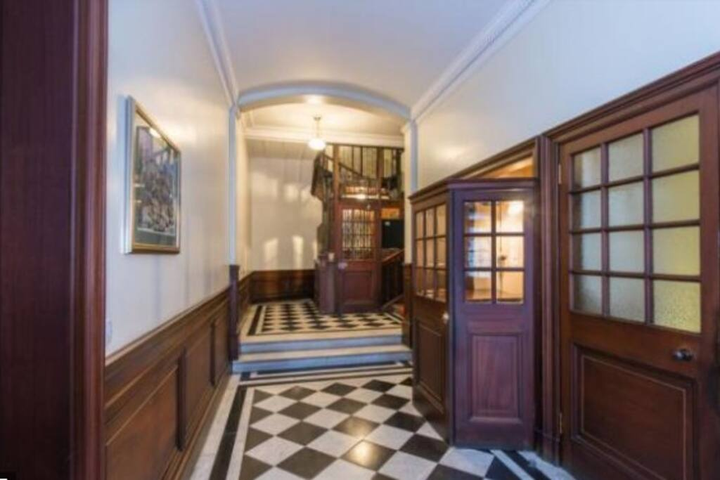 Ground floor entrance hall with Concierge's reception, leading to historic Edwardian Lift and staircase