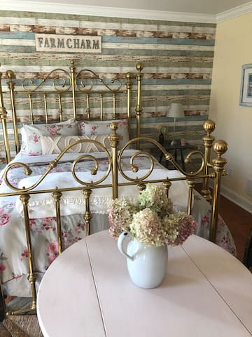 A beautiful antique big brass bed..... total romance and relaxation.