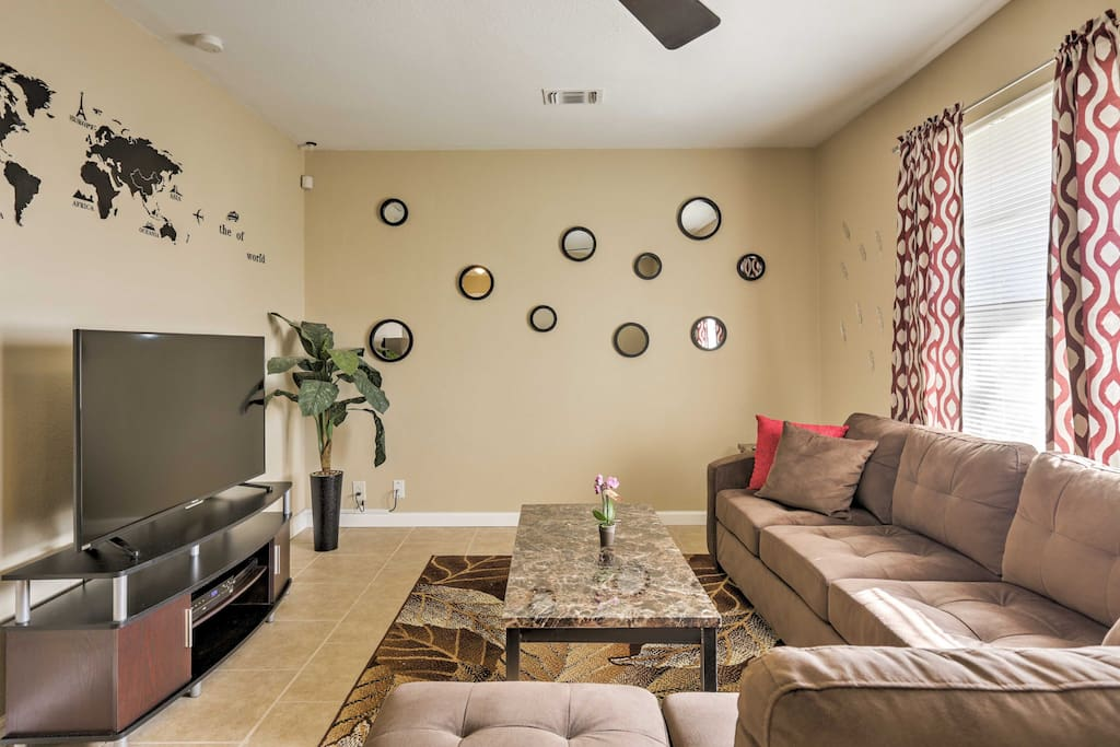 The cozy living room offers comfortable furnishings, creating the ideal space to relax after a long day.