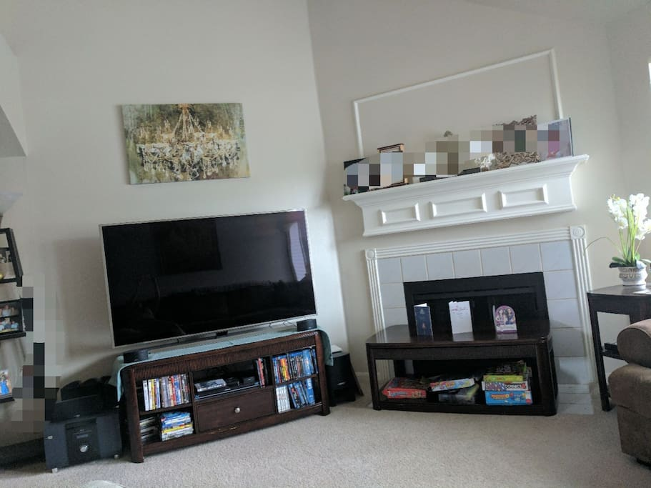 living room downstairs has a new 65inch tv with Netflix, Hulu, hbo, local cable and lots of dvd's.