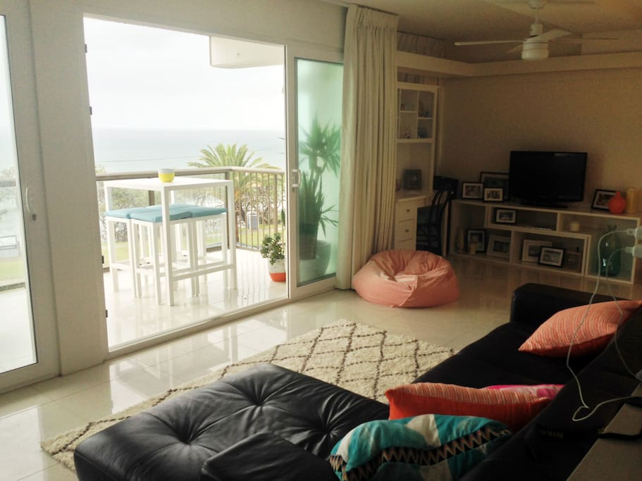 Modern open plan with views to beach from couch :)