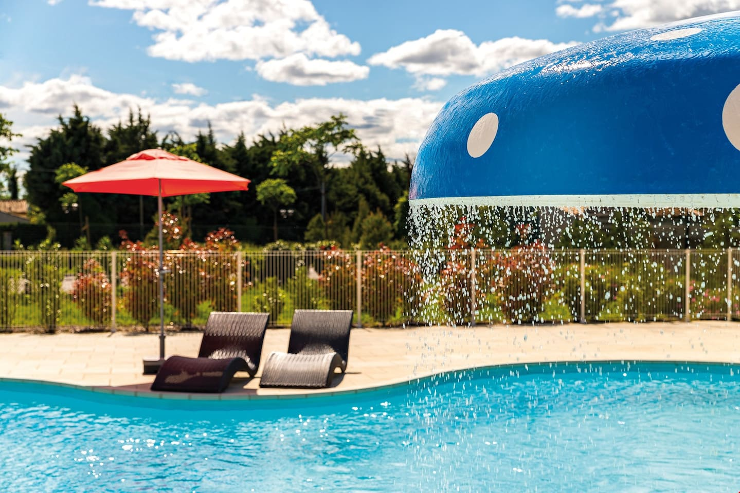 Enjoy relaxing by the outdoor swimming pool.