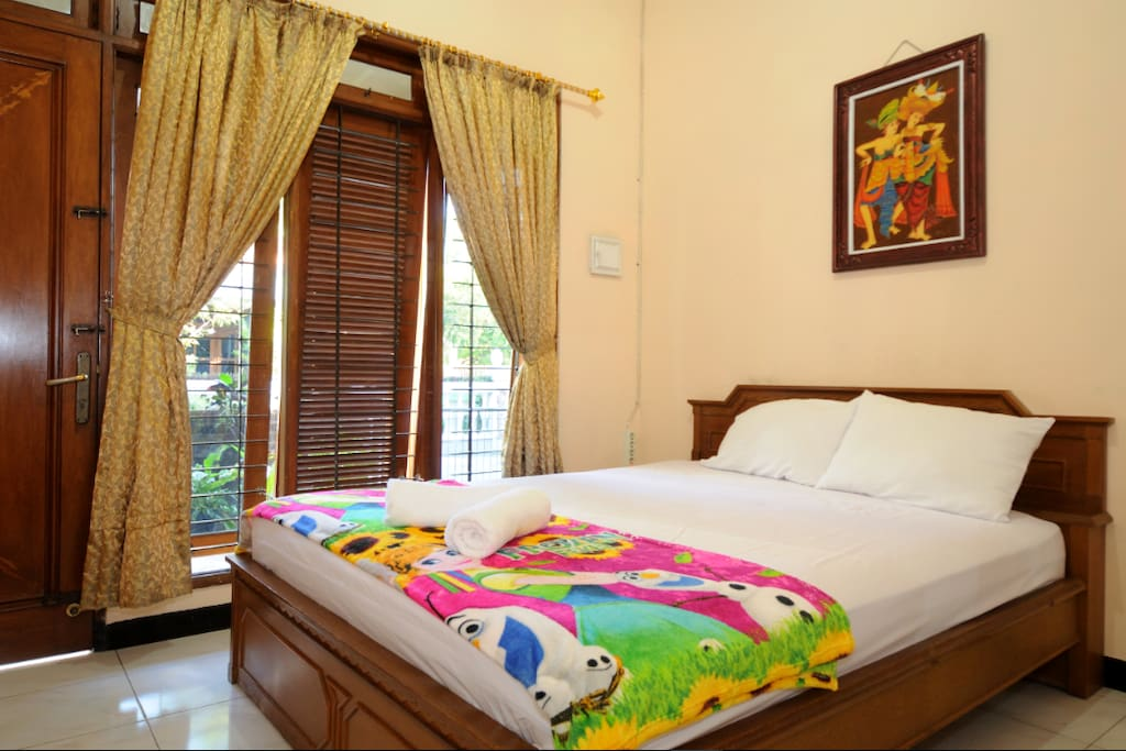 Main bedroom with direct access to garden and private entrance.