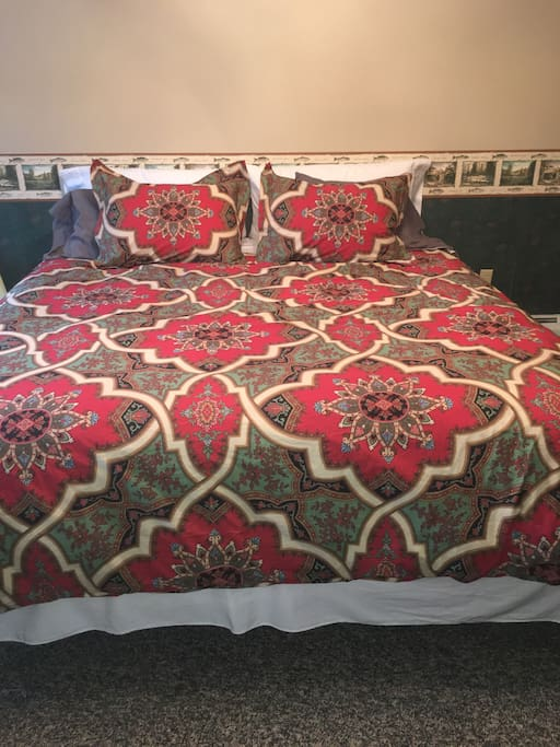 Comfortable king pillow top bed.